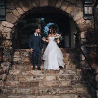 Pic of wedding couple on stone staircase